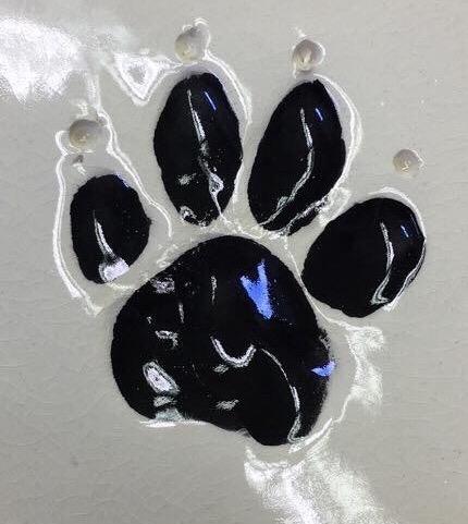 dog paw prints clay ceramic