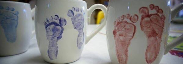 Baby footprints on mugs