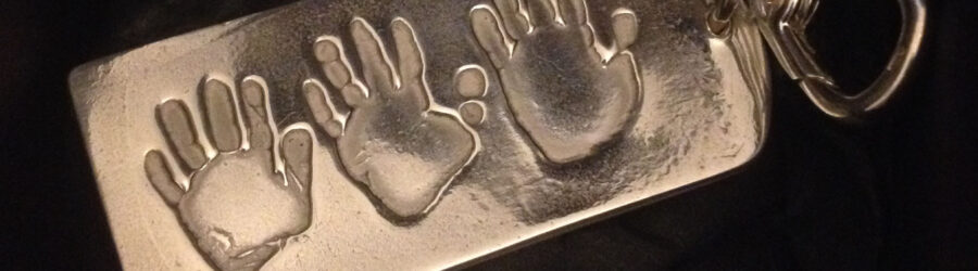Silver key chain with hand prints